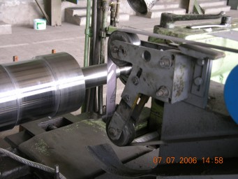 Belt-grinding devices and machine tools 0